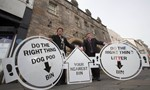 Councillors pictured holding pavement stencils used in the Council's Do the Right Thing litter campaign