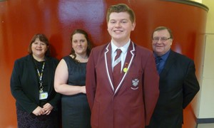 Michael McKernan (front, centre) with (L-R) Vale of Leven Academy headteacher Catriona Robertson; Council youth worker Janice O'Connor; and Councillor Tommy Rainey.