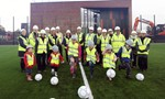 Balloch Campus - some children kicking footballs on the new pitch