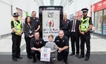Picture shows Conor Darroch, kneeling centre, showing off his winning design alongside staff from the Scottish Fire and Rescue Service and Police Scotland, Councillor Lawrence O'Neill, and his class teacher Kelly Niccolls.