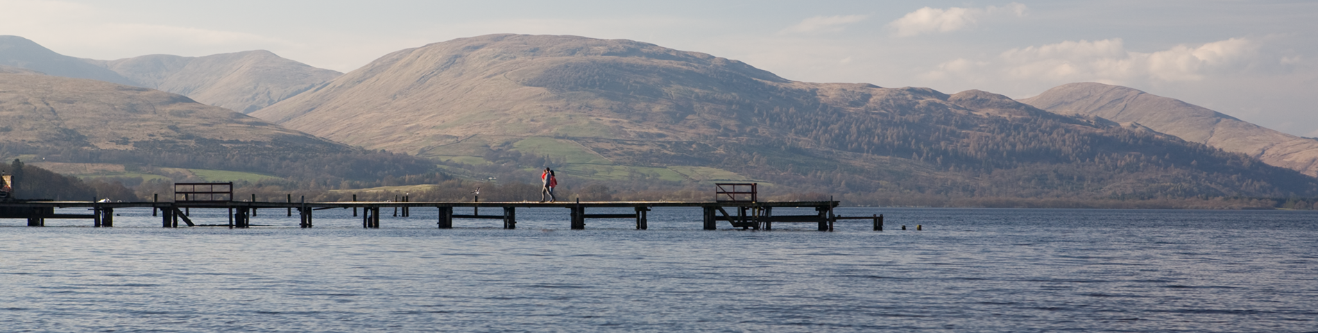 Pier on Loch Lomond with the hills in the background
