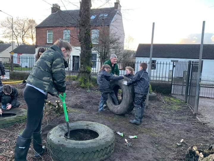 Haldane Youth Services - putting tractor tyres on garden