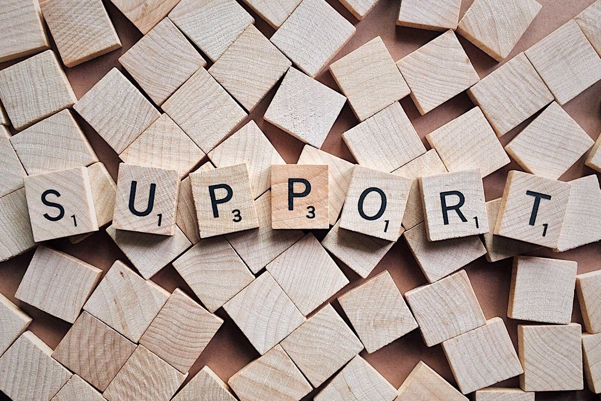 Support - written in wooden scrabble letters