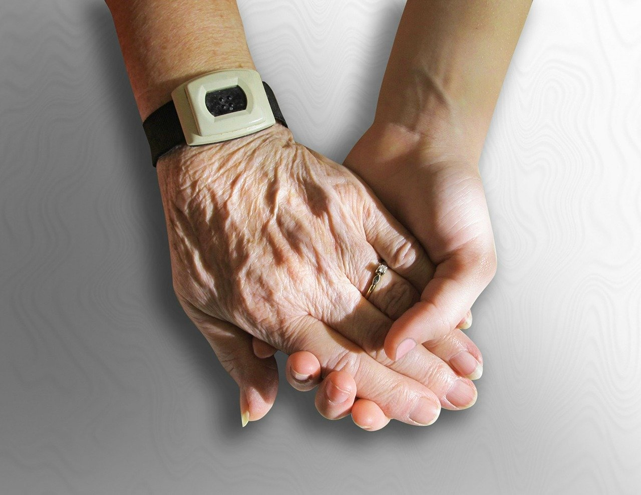 Image of elderly and young hands