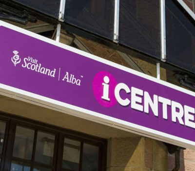 Visit Scotland iCentre sign above a door